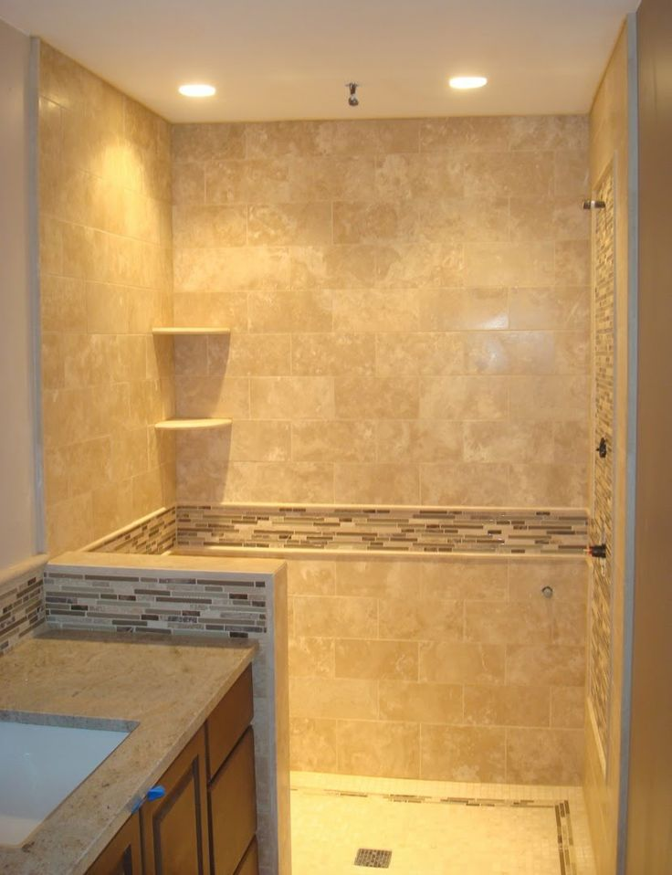 Natural stone or porcelain tile earth 1st flooring for Bathroom travertine tile designs