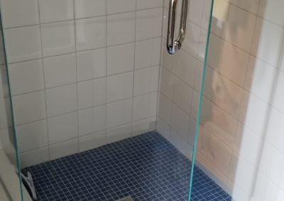 Tiled Corner Shower and Marmoleum